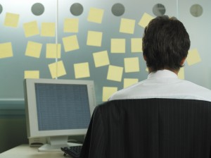 Man with adhesive notes in his office