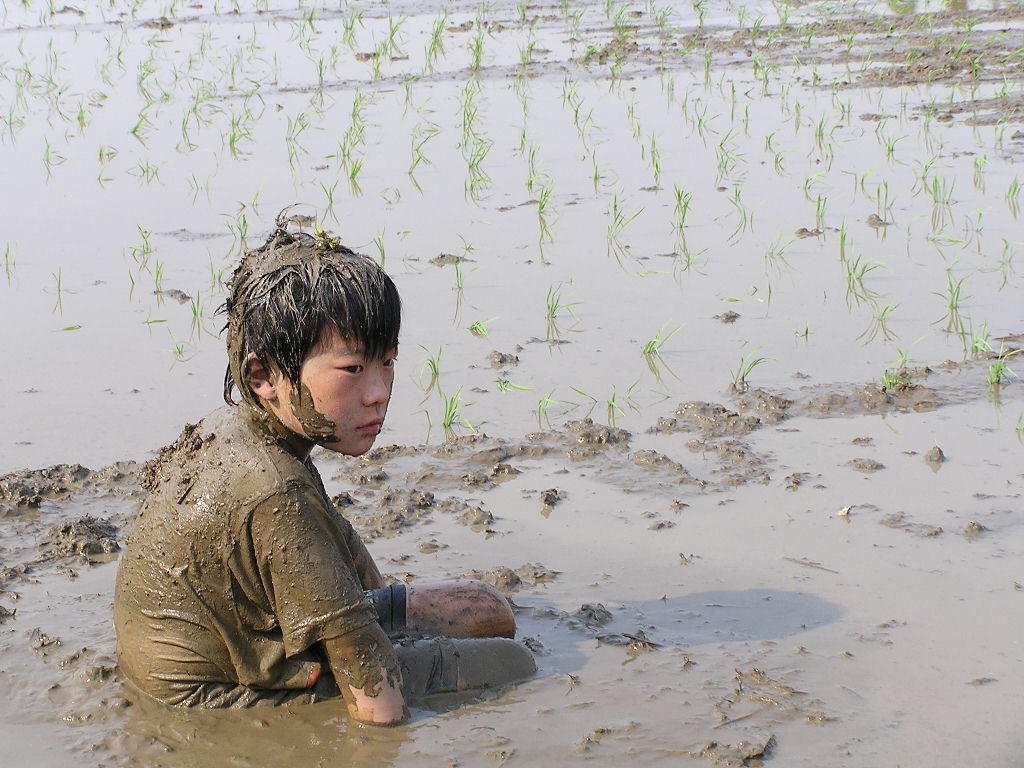 "Photo courtesy of Yamanaka Tamaki ""mud boy in the rice field"" - Attribution-NonCommercial-NoDerivs 2.0 Generic (CC BY-NC-ND 2.0) (http://bit.ly/stuckinmud)."