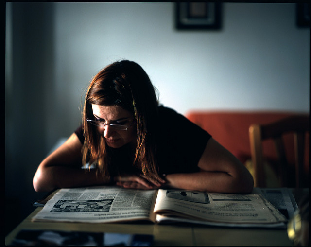 Emma reading the newspaper by Diego Sevilla Ruiz of Flickr